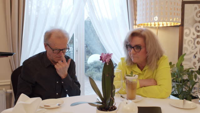 senior couple talking and waiting for winter tea in restaurant. - real life stock videos & royalty-free footage