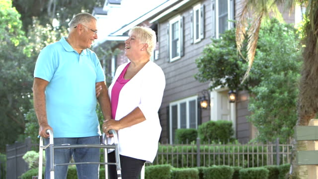 senior couple talking, laughing - man with walker - mobility walker stock videos and b-roll footage