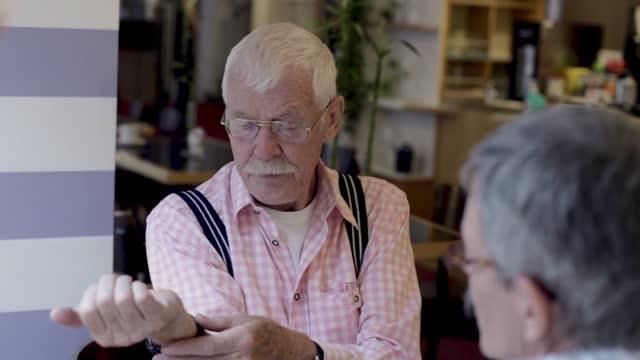senior couple talking over breakfast - wrist watch stock videos & royalty-free footage