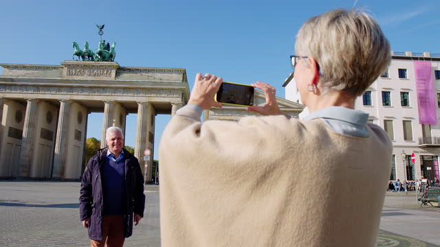 senior couple traveling to berlin taking photos - in front of stock videos & royalty-free footage