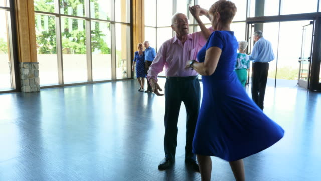 pan senior couple twirling during dance in ballroom - over 80 stock videos and b-roll footage