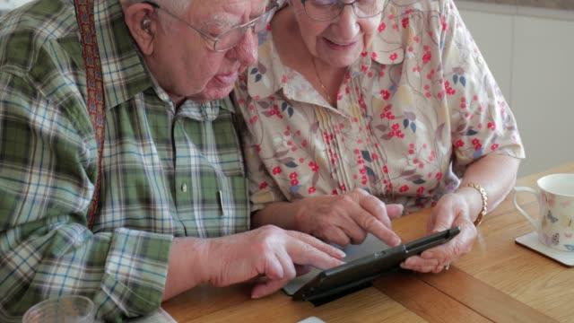 Senior Couple Using a Digital Tablet