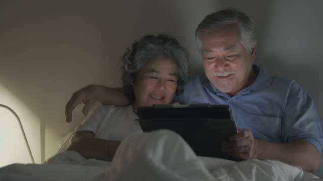 senior couple using tablet. - human relationship stock videos & royalty-free footage
