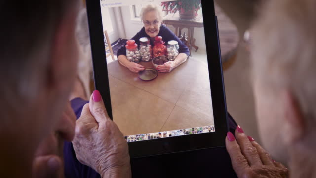 senior couple using tablet - moving image stock videos & royalty-free footage