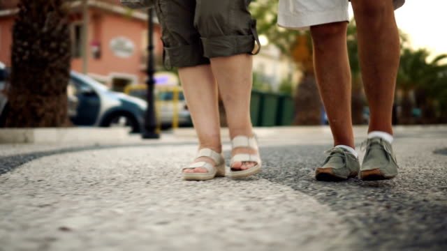 senior couple walking by the sea - sandal stock videos & royalty-free footage