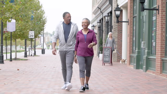 senior couple walking for exercise - wife stock videos & royalty-free footage