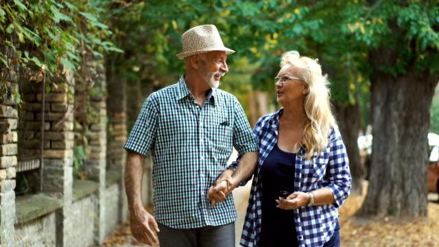 senior couple walking in the street. - active seniors stock videos & royalty-free footage