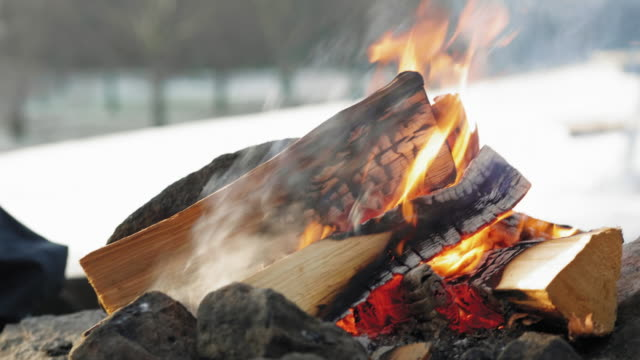 senior couple warming up by a campfire - open fire stock videos & royalty-free footage