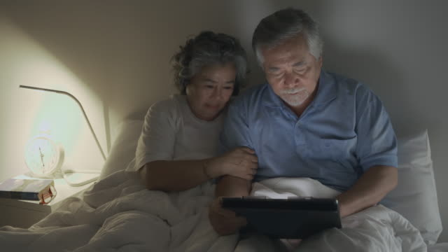 senior couple watching movie oh my god, a jump scare and frightened. - ethnicity stock videos & royalty-free footage