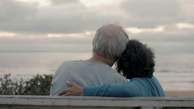 senior couple watching sunset at beach - husband stock videos & royalty-free footage