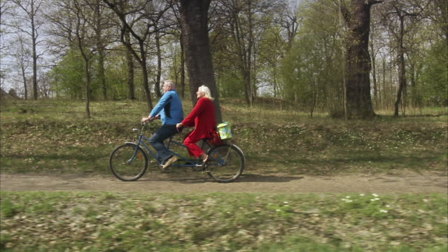 Senior couple with a tandem, Sweden.