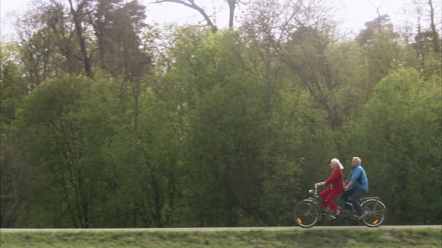 senior couple with a tandem, sweden. - tandem stock videos & royalty-free footage