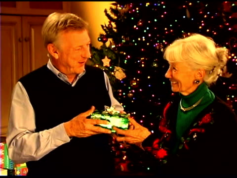 senior couple with christmas gift - see other clips from this shoot 1407 stock videos and b-roll footage