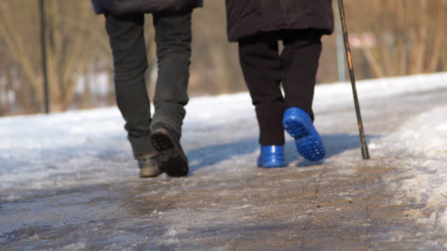 Senior couple with walking sticks
