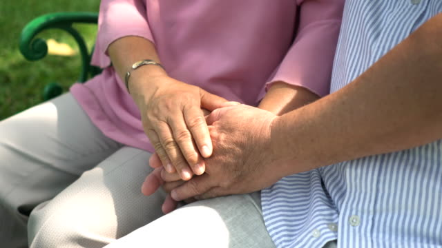 Senior couple's hand in positive motion