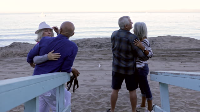 senior couples romantic on the beach - beach house stock videos & royalty-free footage
