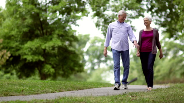 senior couples walking in park - walking stock videos & royalty-free footage