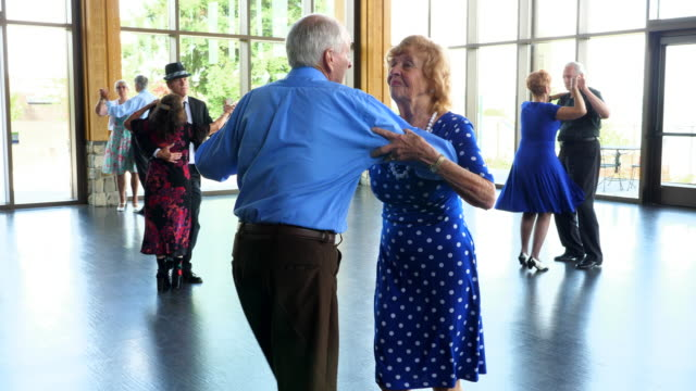 ts senior couples waltzing during dance in community center - ballroom dancing stock videos & royalty-free footage