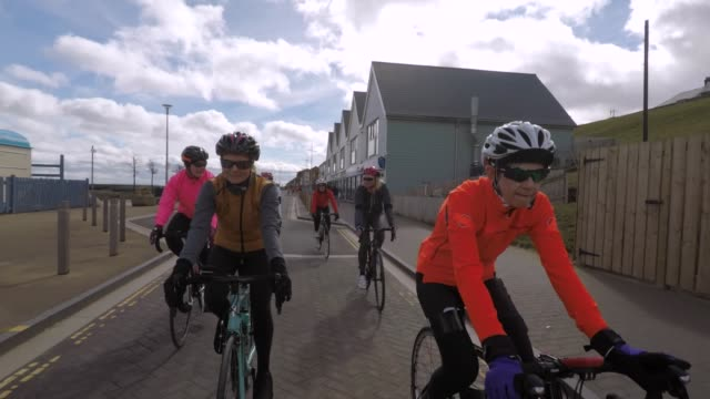 senior cyclists by the coast - wearable camera stock videos & royalty-free footage
