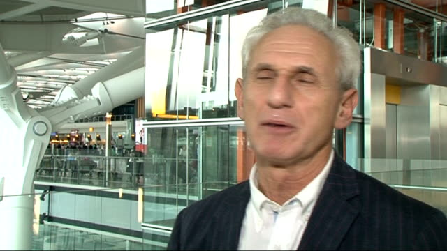 senior daily mail journalist says miliband article was wrongly labelled; heathrow airport: terminal 5: int alex brummer along alex brummer interview... - daily mail stock videos & royalty-free footage