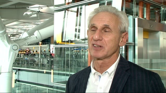 senior daily mail journalist says miliband article was wrongly labelled; heathrow airport: terminal 5: alex brummer interview sot - talks of article... - daily mail stock videos & royalty-free footage