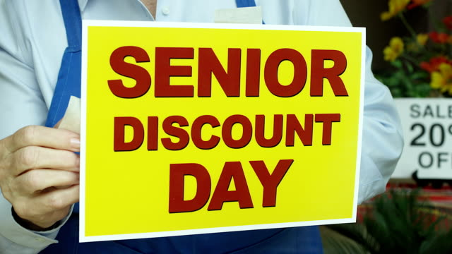senior discount store sign - poster stock videos & royalty-free footage