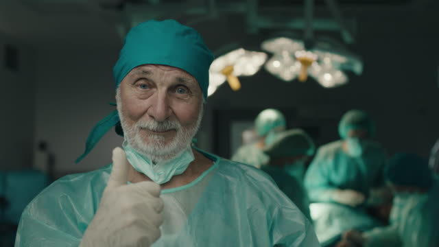 senior doctor showing thumbs up - satisfaction stock videos & royalty-free footage