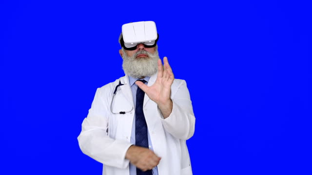 Senior doctor using virtual reality glasses  on a blue background