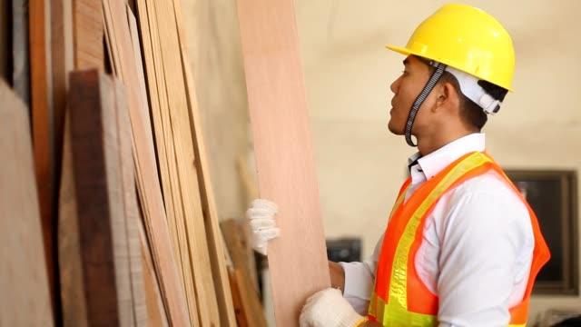 senior engineer inspecting timber - white shirt stock videos & royalty-free footage