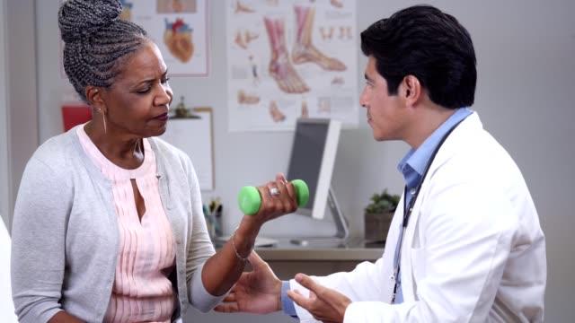 A senior female patient follows her doctors instructions
