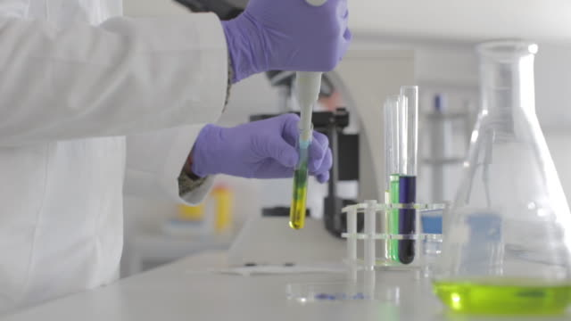 senior female scientist working in laboratory - biochemistry stock videos & royalty-free footage
