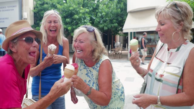 senior friends enjoying ice cream - holiday event stock videos & royalty-free footage