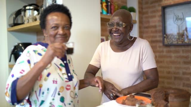 senior friends having fun at coffee break in the kitchen - retirement community stock videos & royalty-free footage