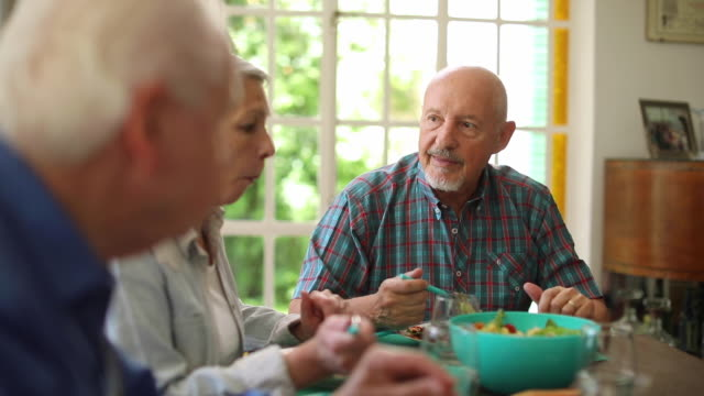 senior friends having lunch - dining room stock videos & royalty-free footage