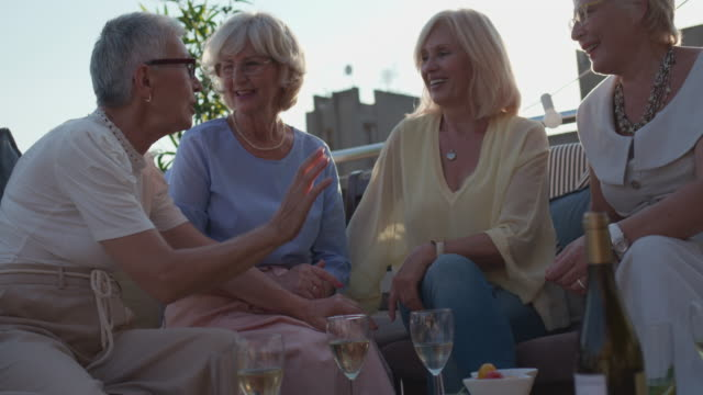 senior friends on rooftop party - cards stock videos & royalty-free footage