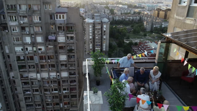 senior friends on rooftop party - building terrace stock videos & royalty-free footage