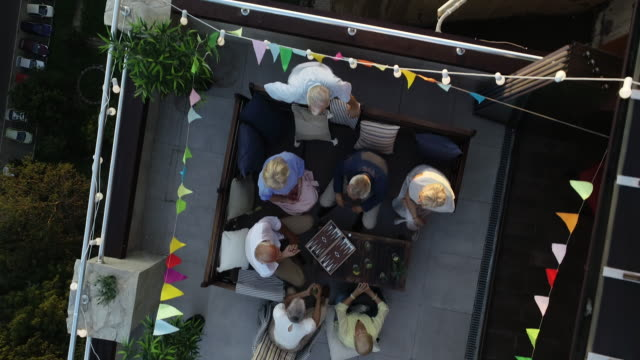 senior friends on rooftop party - short hair stock videos & royalty-free footage