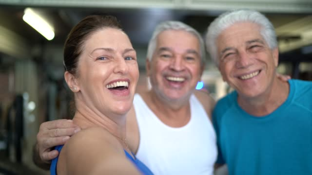 senior friends photographing at the gym - pov of camera - aerobics stock videos & royalty-free footage