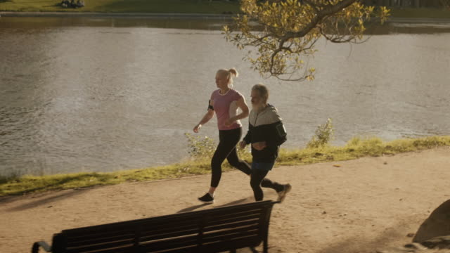 senior friends running together (slow motion) - practising stock videos & royalty-free footage
