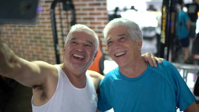 senior friends taking a selfie at gym - baby boomer stock videos & royalty-free footage