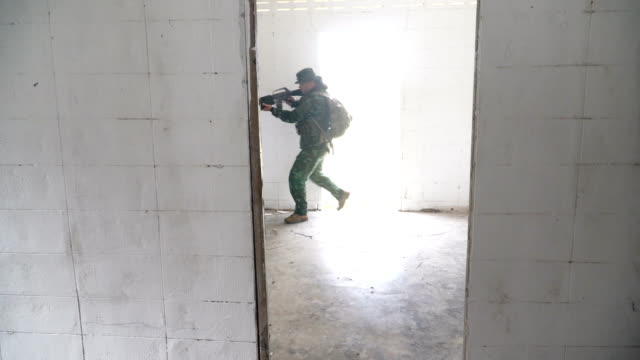 Senior fully Equipped and Armed Soldiers patrol in unknown house