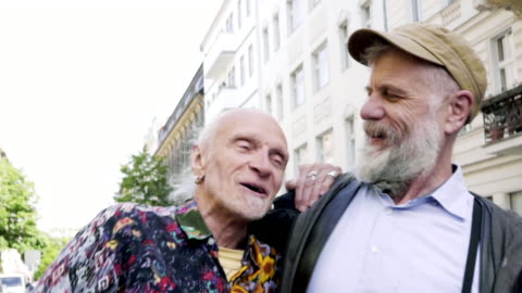 senior gay men walking together - arm around stock videos & royalty-free footage