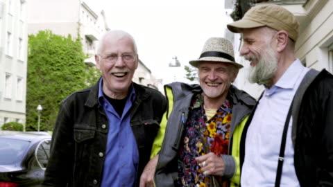 senior gay men walking together - three people stock videos & royalty-free footage