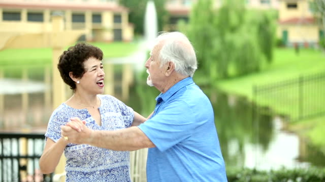 Senior Hispanic couple dancing together