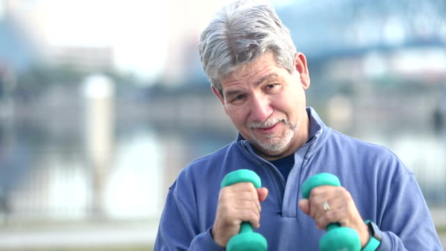 senior hispanic man boxing with hand weights - hand weight stock videos & royalty-free footage