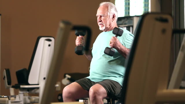 senior hispanic man exercising at gym, lifting weights - over 80 stock videos and b-roll footage