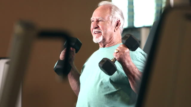 senior hispanic man exercising at gym, lifting weights - weight training stock videos & royalty-free footage