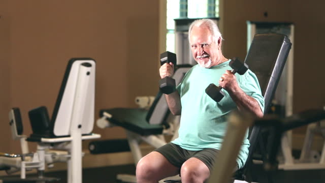 senior hispanic man exercising at gym, lifting weights - moustache stock videos & royalty-free footage