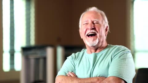 senior hispanic man looking at camera, smiling, laughing - white hair stock videos & royalty-free footage