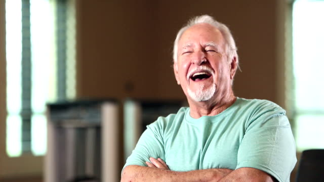 senior hispanic man looking at camera, smiling, laughing - moustache stock videos & royalty-free footage